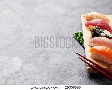 Set of sushi on stone table. View with copy space