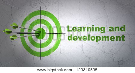 Success Studying concept: arrows hitting the center of target, Green Learning And Development on wall background, 3D rendering