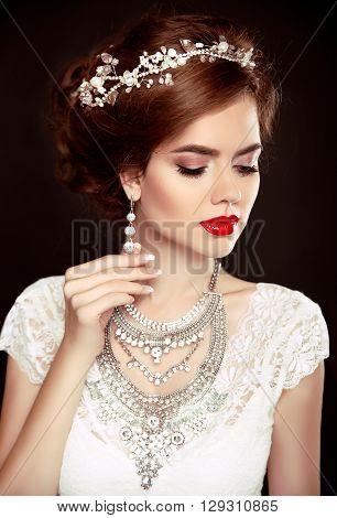 Beauty Woman Portrait. Wedding Hairstyle. Beautiful Fashion Bride Girl Model. Luxury Jewelry. Manicu