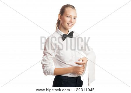Portrait of smiling young waitress looking at camera while holding white towel on arm