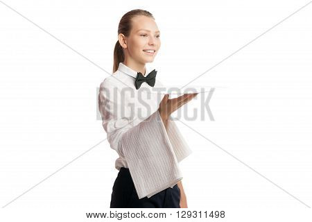 Portrait of smiling blonde waitress in uniform holding tray with towel