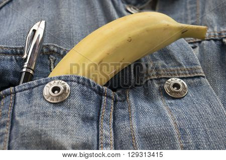 ripe banana in the breast pocket of a denim jacket