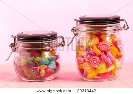 Colorful Candy In Bottle On Pink Background