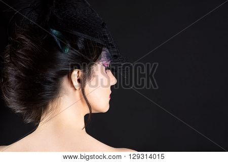 beautiful woman with luxurious hair isolated on black