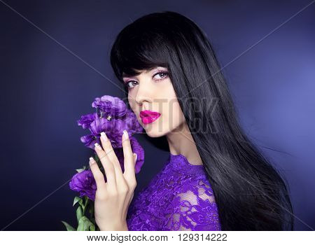 Makeup. Long Hair. Beautiful Brunette Woman With Purple Flowers, Manicured Nails, Healthy Black Hair