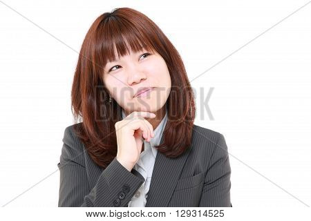 portrait of young Japanese businesswoman worries about something