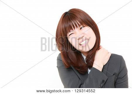 portrait of Japanese businesswoman suffers from neck ache