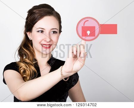 technology, internet and networking concept. beautiful woman in a black business shirt. woman presses unlock button on virtual screens, empty field for notes in search bar on virtual screen.