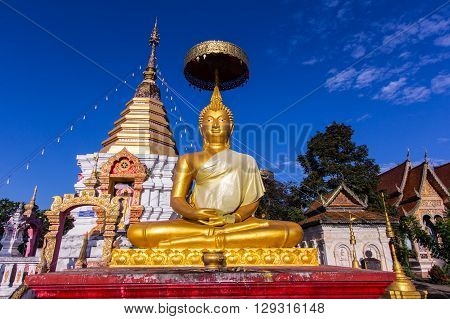 thai golden buddha statue with pagoda , asia