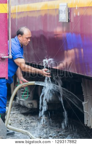 Bangkok Thailand - February 2 2016 : Unidentified railway employees working for restoration the railway before departure at State Railway of Thailand.