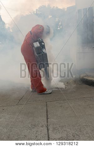 Bangkok Thailand - January 31 2016 : Unidentified people fogging DDT spray kill mosquito for control Malaria Encephalitis Dengue and Zika in village at Bangkok Thailand.