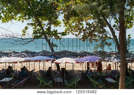 Rayong Thailand - December 31 2015 : Unidentified people travel at LaemMaePhim. This white sandy cape can be easily reached from city. Without large waves the beach is nice for swimming.
