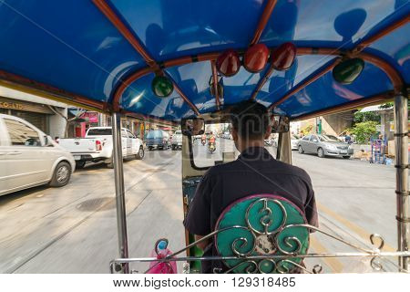 Bangkok Thailand - March 6 2016 : Thai TukTuk taxi running on the road in Bangkok Thailand.