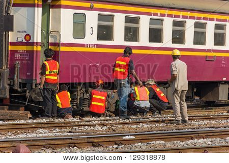 Bangkok Thailand - April 26 2016 : Unidentified railway employees working for restoration the railroad tracks before serving at State Railway of Thailand.