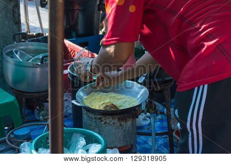 Bangkok Thailand - April 10 2016 : Thai exotic food in street food market. Like the charming people exotic foods greets you on almost every corner in Thailand.