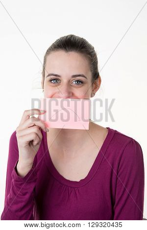 Young Woman With A Post-it Note On Her Mouth Smiling