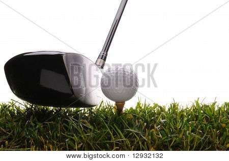 Golf Ball On Tee In Grass With Driver