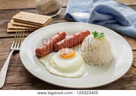 a plate with boiled rice egg and sausage