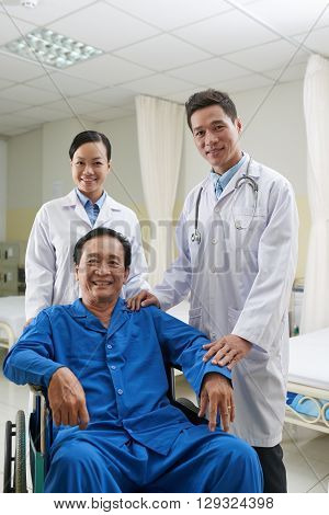 Doctor, nurse and happy mature patient: successful recovery