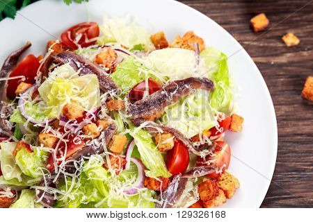 Fresh healthy Classic Caesar salad with anchovies