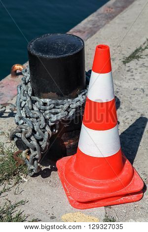 Red Striped Warning Road Cone On Pier