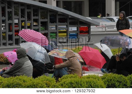 ANKARA/TURKEY-MAY 8, 2016: Spectators at the Sinpas Altin Oran Square during the 20. International Ankara Jazz Festival with umbrellas. May 8, 2016-Ankara/Turkey