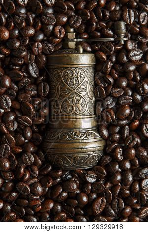 roasted coffee beans background texture hand coffee mill