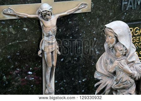 HOHENBERG, GERMANY - MAY 06: Virgin Mary with baby Jesus looks at Jesus crucified on the cross, Cemetery in Hohenberg, Germany on May 06, 2014.