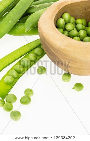 Fresh Green Pea Pods And Peas In Wooden Bowl, On White Background