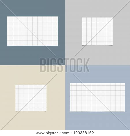 Pieces of cut white squared notebook paper with shadow are stuck on colorful background.