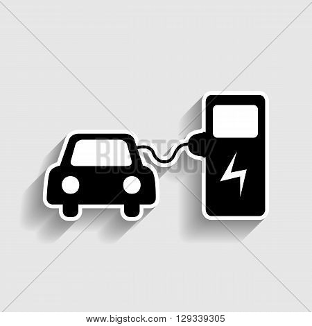 Electric car battery charging sign. Sticker style icon with shadow on gray.