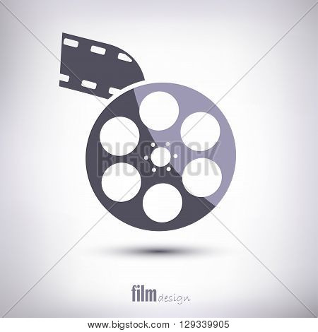 Reel of film is linear. With tape and shadow. On a gray background.
