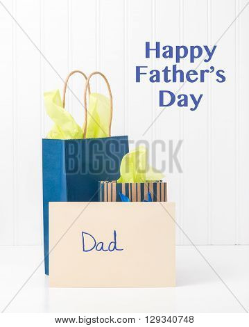 Gift bags and a card for dad on Father's Day.