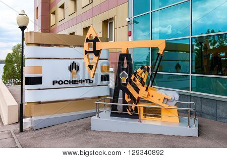 SAMARA RUSSIA - MAY 8 2016: Oil industry equipment. Model of Oil pump jack near the office building of the russian oil company Rosneft in Samara