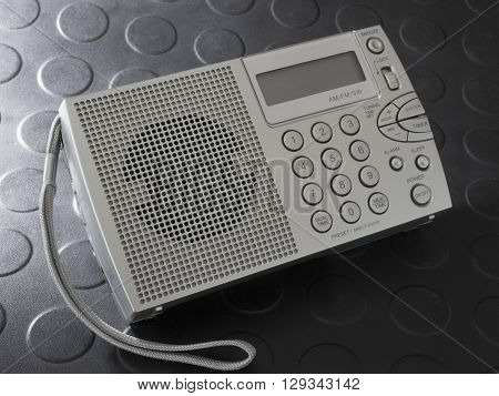 Portable radio that runs on batteries and tunes shortwave and broadcast bands