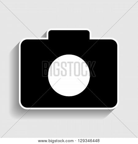 Digital camera  icon. Sticker style icon with shadow on gray.