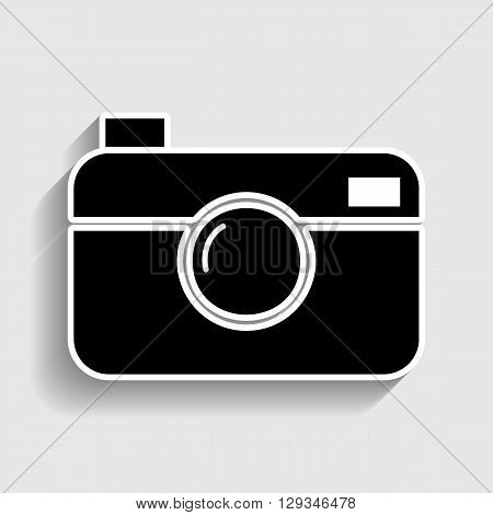 Digital photo camera icon. Sticker style icon with shadow on gray.