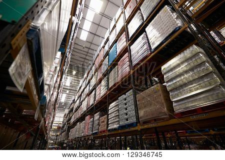 Low angle view of stock stored in a distribution warehouse