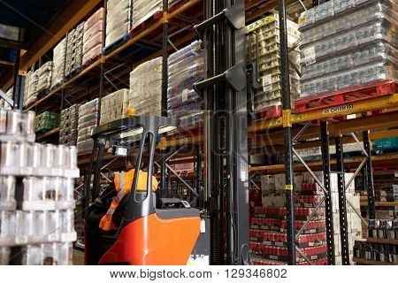 Moving stock in distribution warehouse with an aisle truck