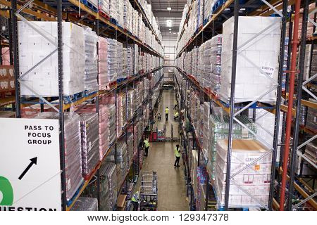 Elevated view of aisle between storage units in a warehouse