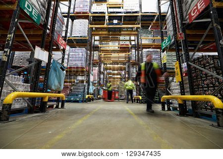 An aisle between storage units in a supermarket distribution warehouse