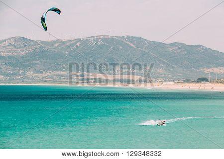 Tarifa, Spain - June 21, 2015: Kite surfing in Tarifa, Spain. Tarifa is most popular places in Spain for kitesurfing.