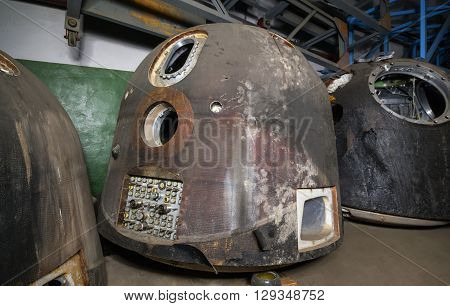 The spacecraft for the descent of man from space after landing. On the dark warehouse before disposal. Focus on the lander