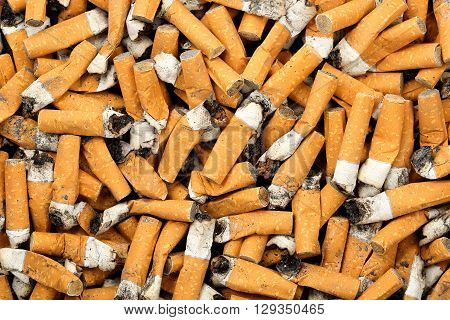 many cigarette butts for background use, abuse concept