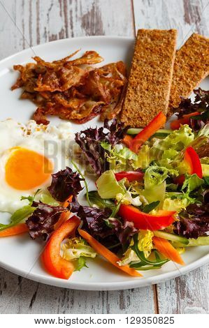 Daily breakfast bekon with salad and egg