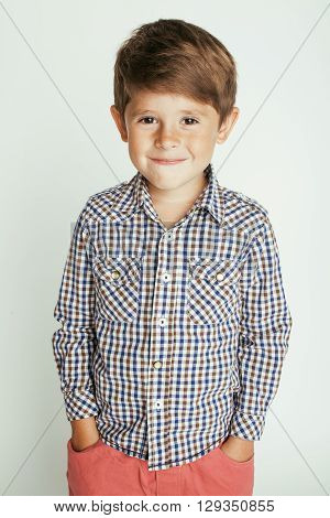 little cute boy on white background gesture smiling close up, adorable real kid