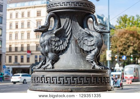 Cast iron birds decorating a lamp post in Vienna