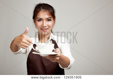 Waitress Or Barista  In Apron Thumbs Up  Holding Coffee