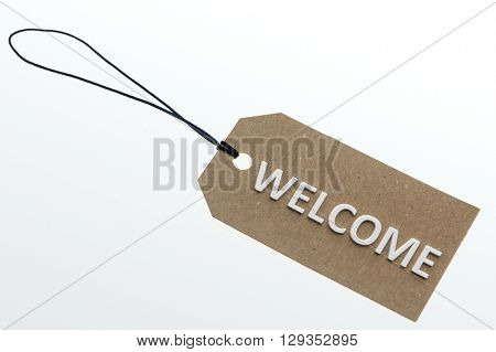 Close-up of 3d rendering WELCOME word on carton label.Isolated.
