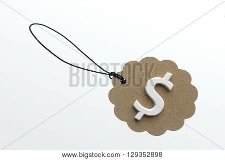 Close-up of 3d rendering sign of dollar on paperboard label.Isolated